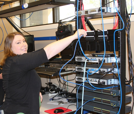 CIS Program student works on WIFI network equipment